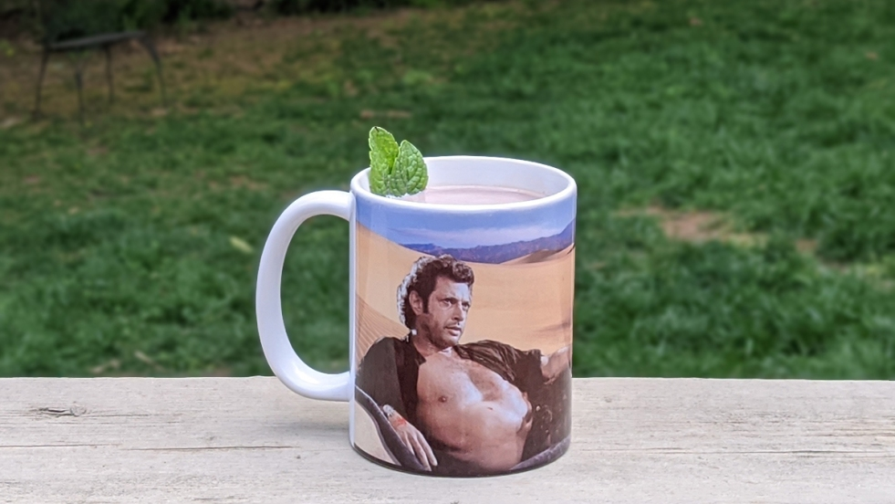 mint hot chocolate in a mug with a photo of Jeff Goldblum on it